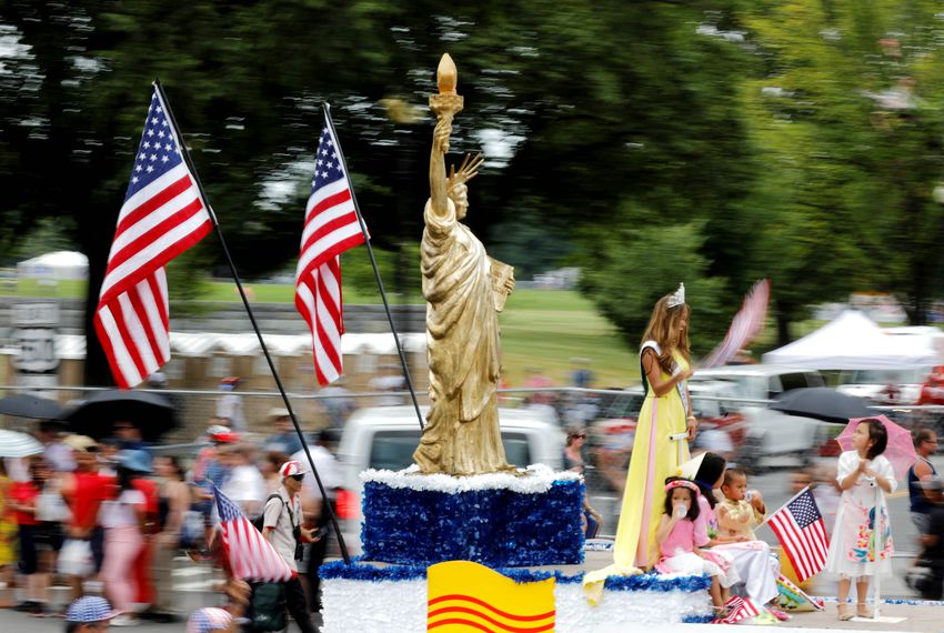 A Statue of Liberty replica passes by at an Independence Day parade in Washington, D.C.