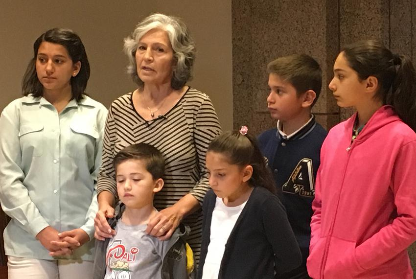 Mercedes Bristol, 62, of San Antonio, at the Capitol with her five grandchildren after testifying to the House Human Servi...