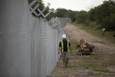 A portion of the newly-erected border fence that is being constructed by the state on private property in Del Rio on July 23, 2021.