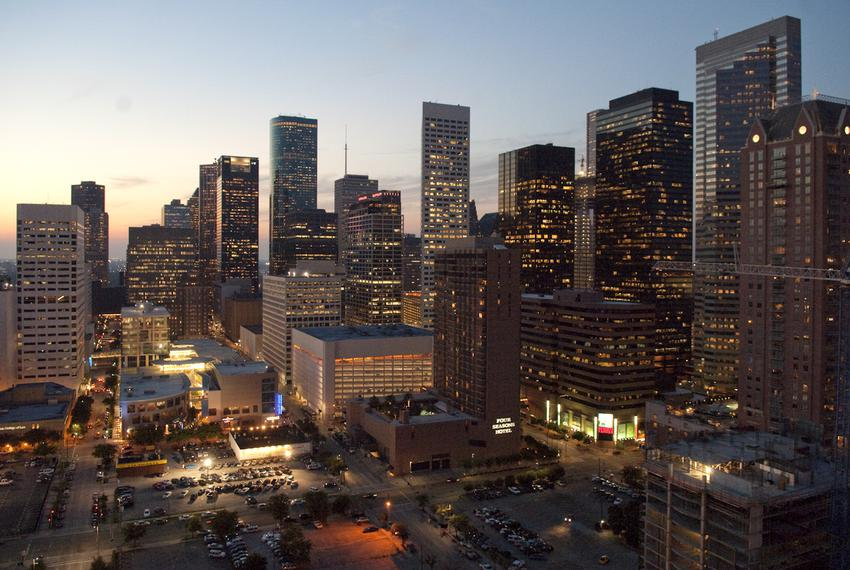 The Houston downtown skyline looking west from the 16th floor of the Hyatt Hotel, next door to the Toyota Center arena where…
