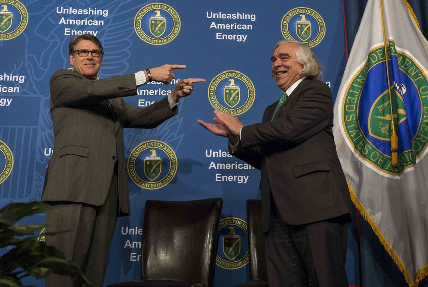 The Trump White House has capitalized on fossil-fuel exports first made possible by the Obama administration. Energy Secretary Rick Perry is shown here on August 2, 2017 welcoming his predecessor, Ernest Moniz, during the unveiling of Moniz's portrait.