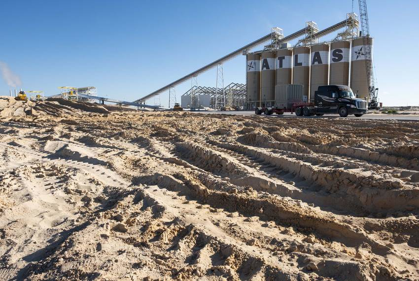 Hundreds of trucks visit Atlas Sand's Kermit Plant each day. Sand mines began popping up in West Texas' Permian Basin region a year ago as an oil boom gained steam.