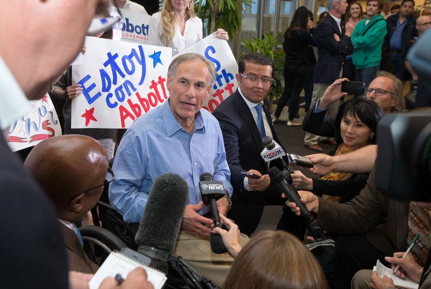 Gov-elect Greg Abbott at an executive aviation terminal on election eve.