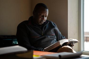 Pastor Madit Chakud reads the bible at the Cactus Nazarene Ministries in Cactus.