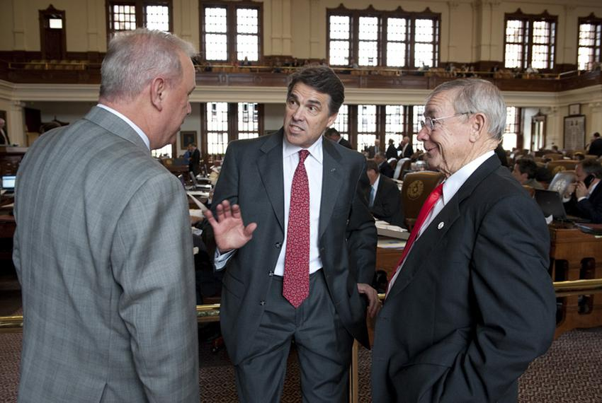 Gov. Rick Perry (c) visits the Texas House and talks to Rep. Gary Elkins (l), R-Houston and Rep. Warren Chisum, R-Pampa, on …