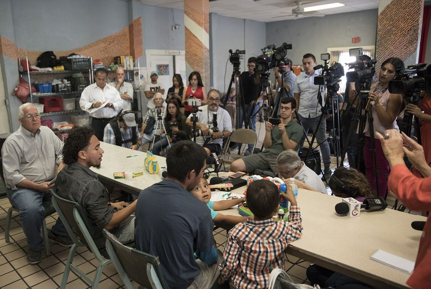 Left to right: Director of the Annunciation House Ruben Garcia, Roger (only first names given), Pablo Ortiz and his 3-year-old son Andres (off frame) and 4-year-old Roger Jr. speak to the media during a press conference at the Annunciation House in El Paso on July 11, 2018. The fathers and sons were released the previous night by ICE.