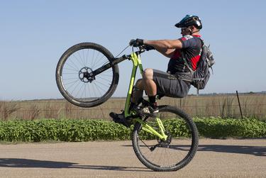 A veteran pops a wheelie at the start of the three-day ride.