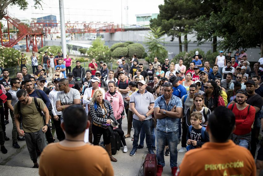 Migrants wait outside the Centro de Atención Integral para Migrantes (CAIM) on May 13, 2019, in Ciudad Juárez. Migrants go the center twice a day to hear the numbers from a wait list to be called out. If their number is called, they are allowed to enter the U.S. to be processed by Customs and Border Protection.