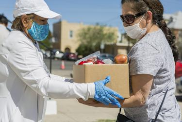 The Kelly Memorial Food Pantry in Central El Paso serves 700-1000 families a day during the Coronavirus pandemic, with lines wrapping around the block. April 7, 2020.