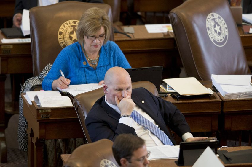 State Rep. Tony Tinderholt, R-Arlington, and State Rep. Molly White, R-Belton, during House budget debate Mar. 31, 2015.