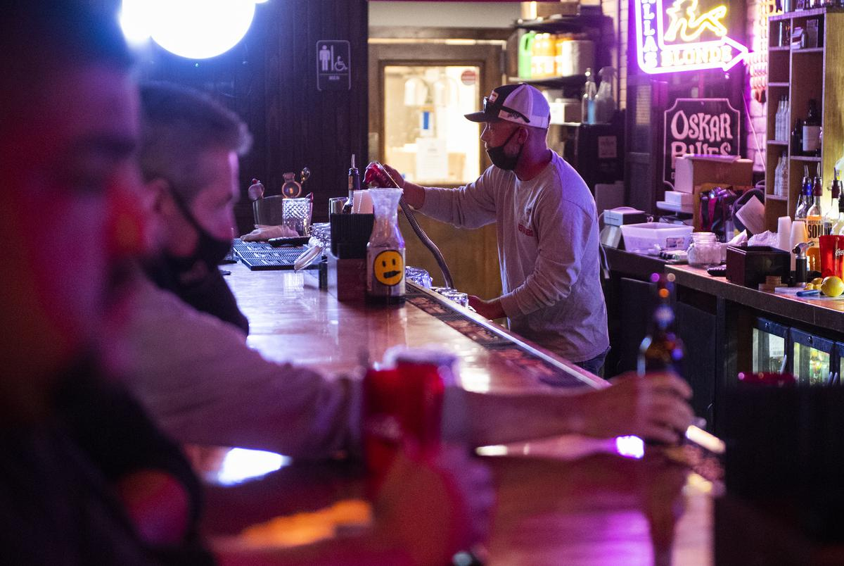 Dustin Allison works behind the bar at Savage Tavern in Lubbock on Saturday, Oct. 24, 2020.
