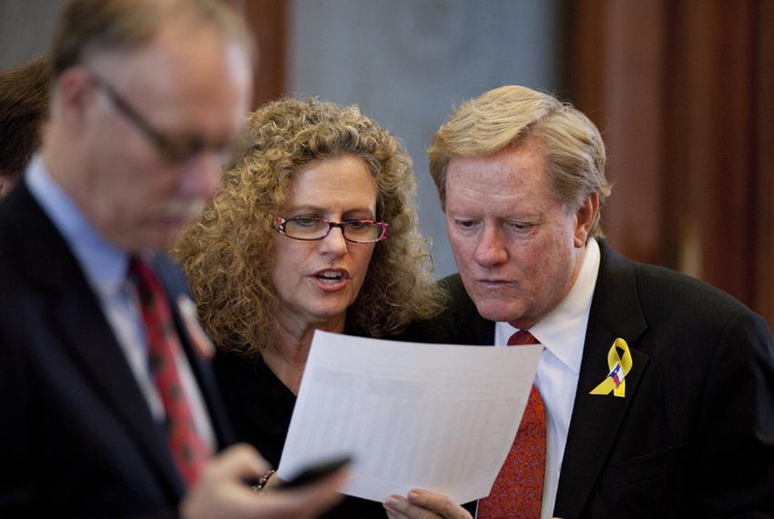 State Rep. Donna Howard (l), D-Austin and State Rep. Jim Pitts (r), R-Waxahachie, go over budget figures in the House on S...
