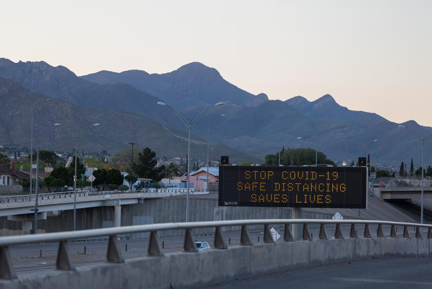 A sign over U.S. Route 54 in El Paso cautions social distancing during the coronavirus pandemic.