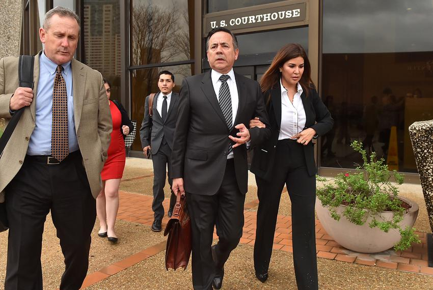 State Sen. Carlos Uresti, D-San Antonio (center) leaves the federal courthouse in San Antonio with his wife, Lleana Uresti...