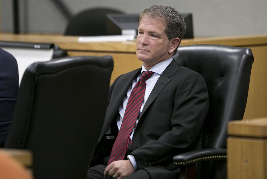 Jack Stick, former chief counsel of the Texas Health and Human Services Commission, sits inside a Travis County courtroom ...