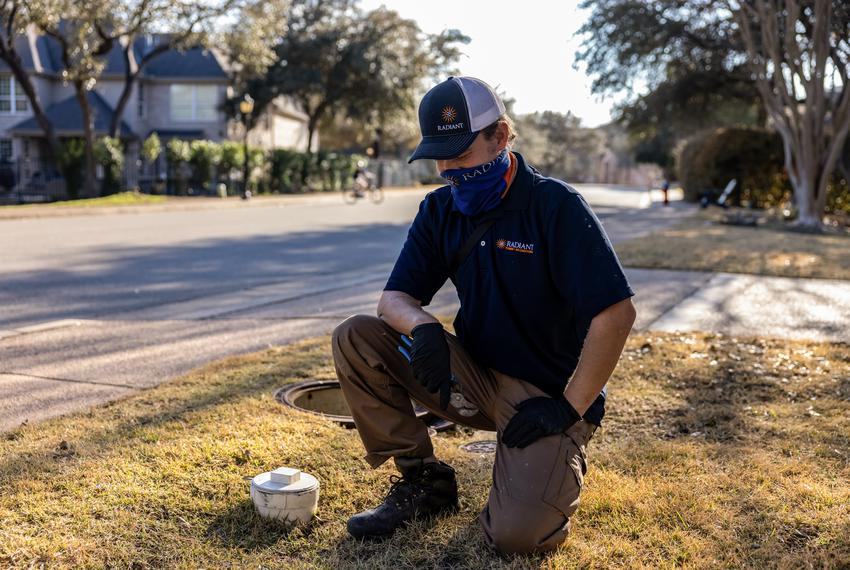 Zachary Shockency, a technician with Radiant Plumbing, turns off a City of Austin water valve at a home in West Austin on Fe…