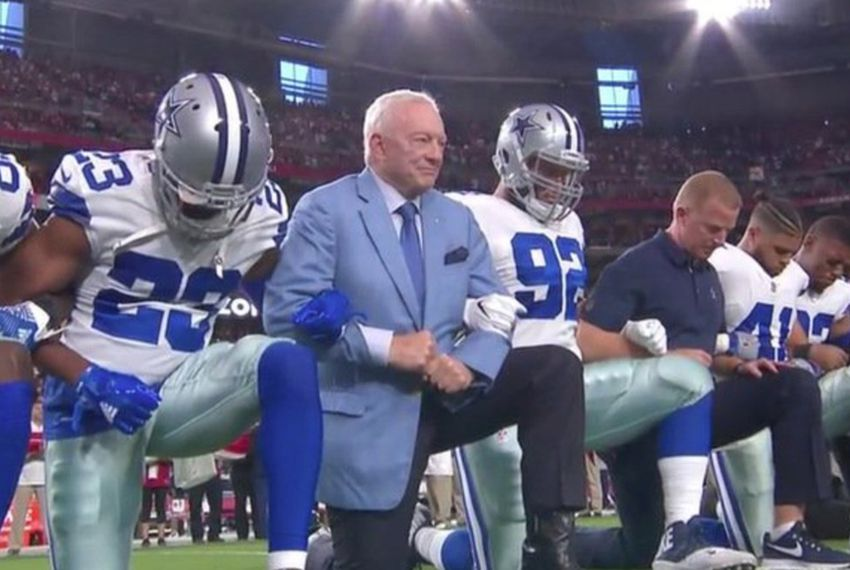 The entire Dallas Cowboys football team takes a knee prior to the national anthem during a game against the Arizona Cardinals onSept. 25, 2017.