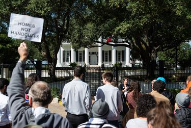 The Homes Not Handcuffs coalition leads a rally in front of the Texas Governor's Mansion in Austin on Saturday, Nov. 2, 2019.