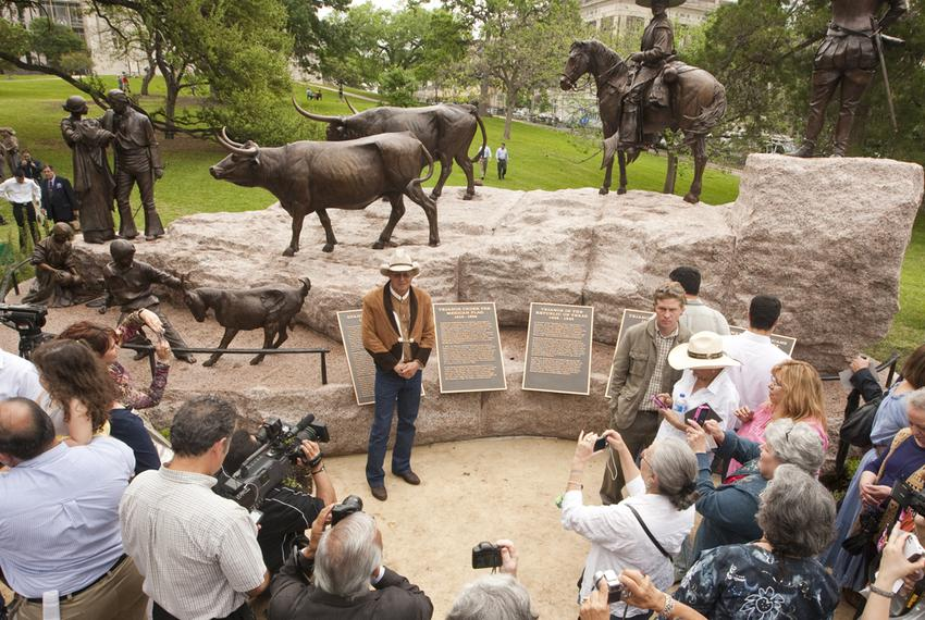 Tejano monument artist Armando Hinojosa in front of the sculpture after its unveiling ceremony on the grounds of the Texas C…
