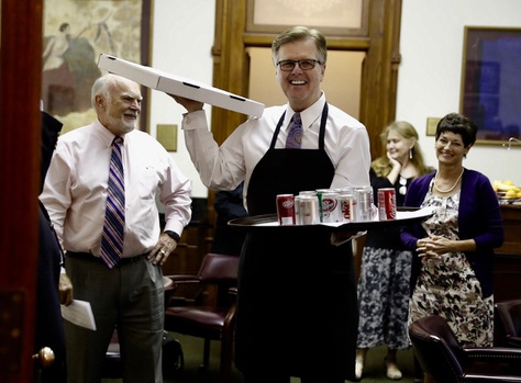 Lt. Gov. Dan Patrick appears in the Texas Senate with pizza and soda as senators arrive for a midnight vote during the special session on July 20, 2017