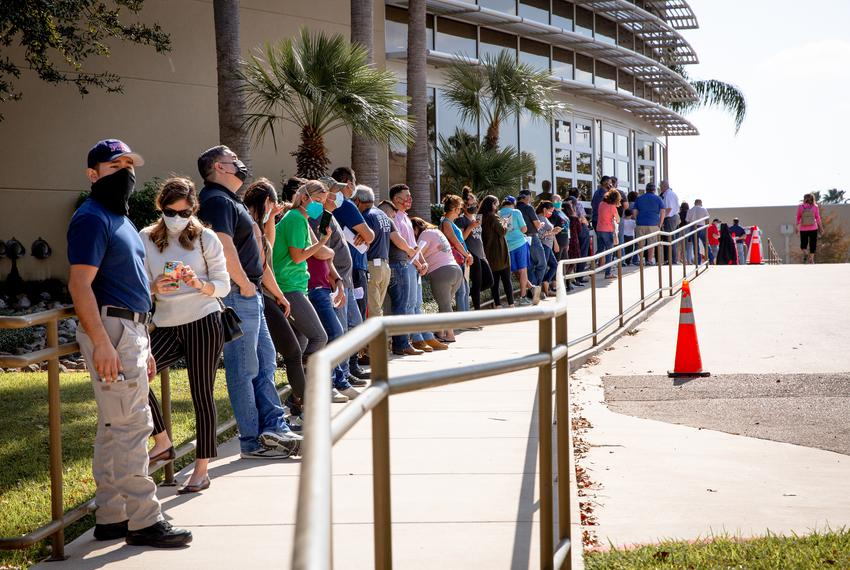 People waited in line at Doctors Hospital at Renaissance Conference Center in Edinburg to receive the Pfizer vaccine on Dec.…
