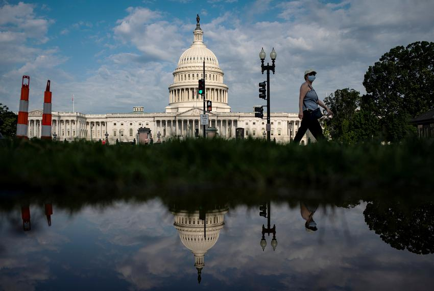 A woman walks past the U.S. Capitol in Washington, D.C.