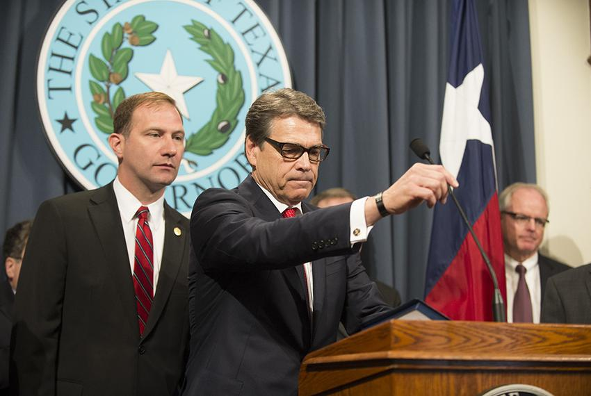 Texas Sen. Dr. Charles Schwertner, R-Georgetown, and Texas Gov. Rick Perry at a Capitol press conference on Monday announcin…