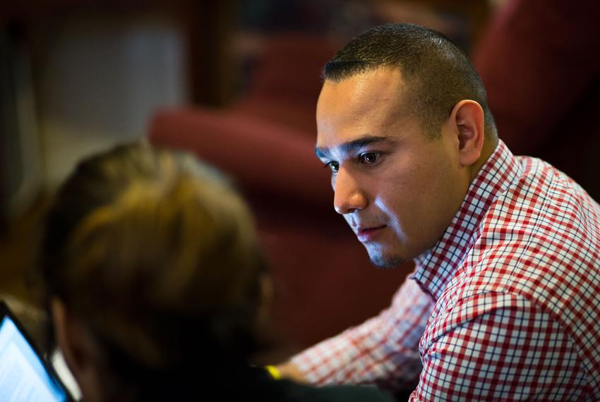 Child Protective Services Investigator Daniel Hernandez interviews family members during a home visit on Mar. 31, 2016.