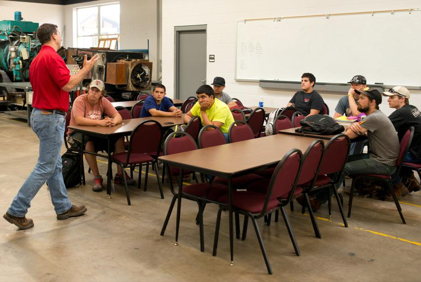 "Keith Plantier lectures in a ""Wind Safety"" course at Texas State Technical College in Sweetwater, Texas, on July, 22, 2013..."