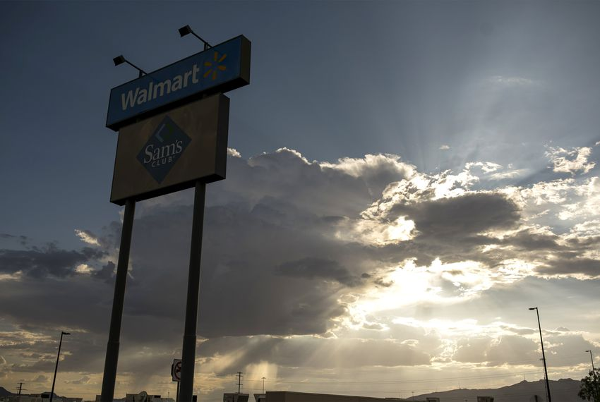 The store sign is seen at the back entrance to the Walmart where a gunman opened fire on back-to-school shoppers, Saturday, August 3, 2019, in El Paso, Texas. Photo by Ivan Pierre Aguirre