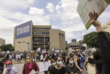 People gathered at Austin Police Headquarters to protest the deaths of George Floyd and Mike Ramos by police officers.
