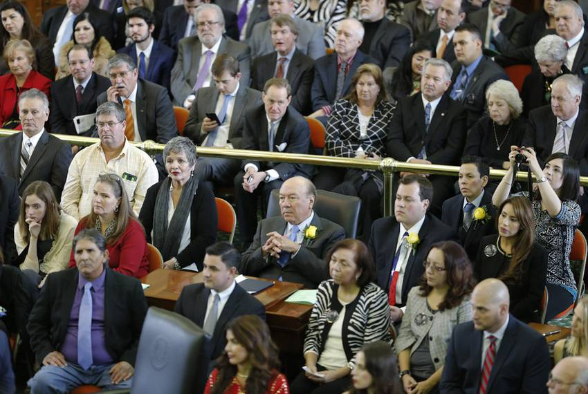 """State Sen. Juan """"Chuy"""" Hinojosa, D-McAllen, (center with yellow rose) listens to seconding speeches in the Senate Chamber ..."""