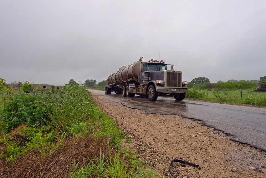 A tanker truck travels on FM 2067 between Austin and Victoria on April 18, 2018. Texas counties are asking state leaders to help pay for road damage caused by heavy traffic from the oil and gas industry.