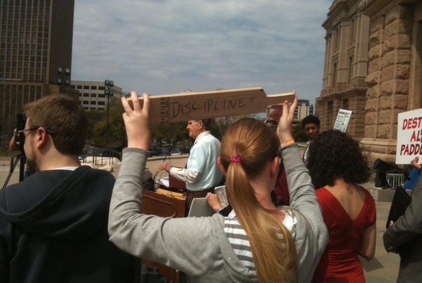 Protesters gathered at the Capitol to support a ban on corporal punishment.