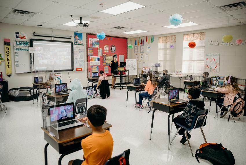 Plexiglass and six feet of distance between each desk keep students socially distant in Abigail Boyett's third grade classro…
