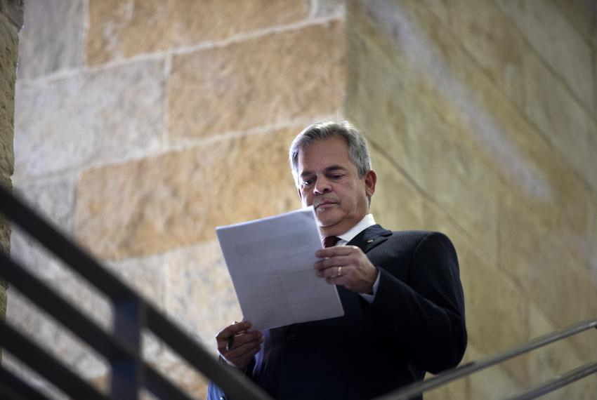 Austin Mayor Steve Adler looks at his speech before a press conference in response to Gov. Greg Abbott's comments about the …