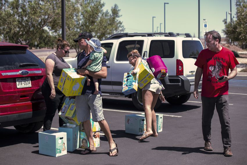 From left: Meagan O'Toole-Pitts; Mark Cortez, holding his son Oliver; Ashley Cortez and Austin Savage attempted to deliver diapers and toys to a Border Patrol facility in Clint on June 24.