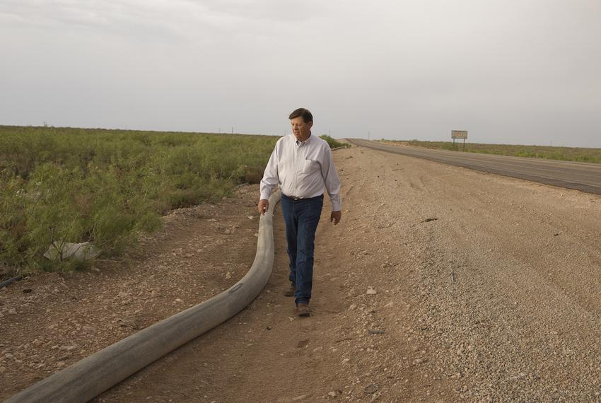 New Mexico State Land Commissioner Aubrey Dunn walks along Highway 652 near the Texas-New Mexico border on May 23, 2018.
