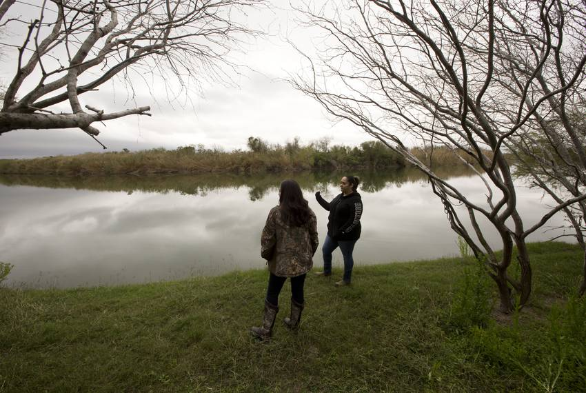 Yvette Gaytan and her neighboor Naida Alvarez  stands close to the Rio Grande river on Alvarez  property in La Rosita, Tex...