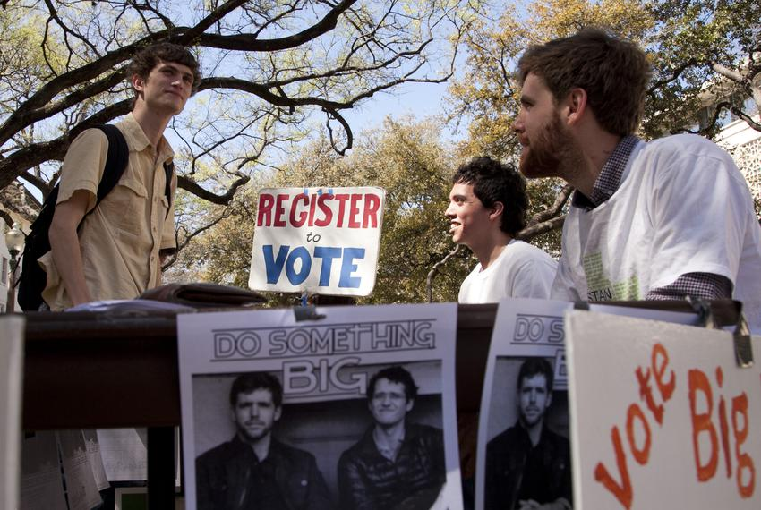John Lawler, a candidate for student body president at the University of Texas, talks with a student on the West Mall.