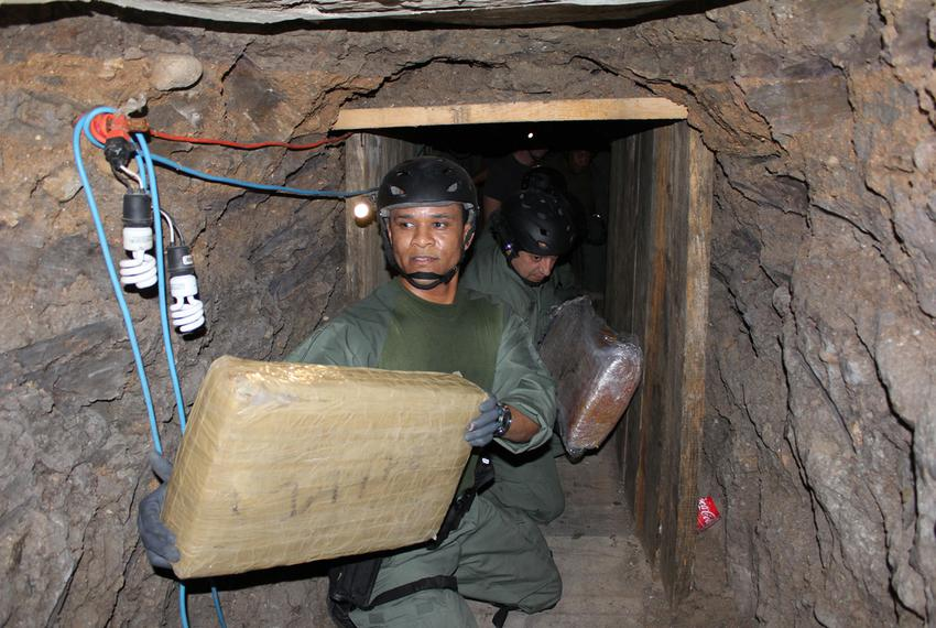 U.S. Immigration and Customs Enforcement inside an elaborate cross-border drug smuggling tunnel discovered inside a warehous…