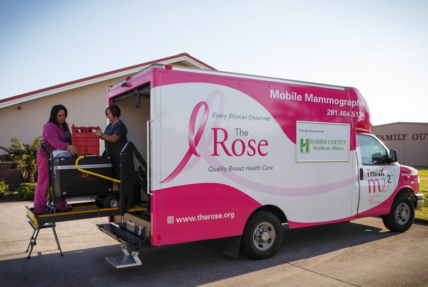 Donna Fehl, right, and Lilia Avila, left, of the Rose unload and set up a mobile mamogram machine at a clinic in Port Arthur…