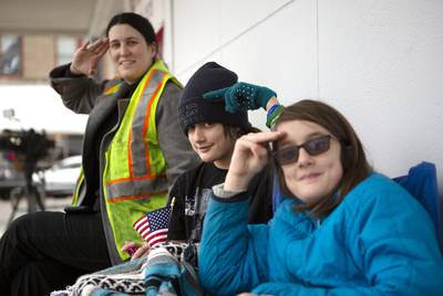 Hayley Enoch, Zoey Johnson and Layla Johnson practiced their presidential salutes on Thursday. The trio arrived early in the morning to the train tracks near Washington Avenue in Navasota.