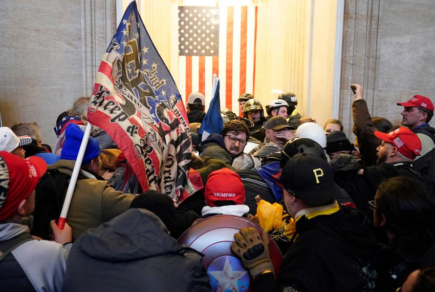 Trump supporters enter the Capitol building during a joint session of Congress in Washington, DC on Jan. 6, 2021. The joint …