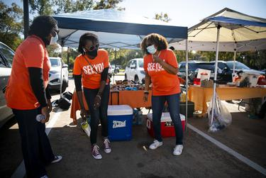 Non-partisan organization See You at the Polls Texas gives out drinks and snacks to voters at the Acres Homes Multi-Service Center on Election Day in Houston on Nov. 3, 2020.