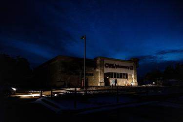 A CVS Pharmacy in South Austin is lit only by the lights of a parked car. Various parts throughout the state lost power as a result of the winter storm.