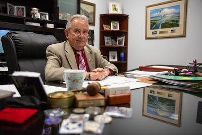"Aransas County Judge C. H. ""Burt"" Mills sits in his office at the temporary county courthouse building, which was hastily remodeled after the storm. ""It's very nice, actually,"" Mills said."