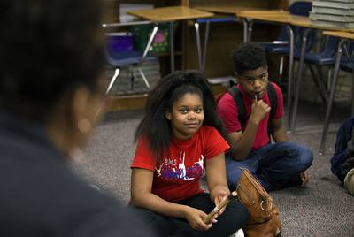 A student at Bammel Middle School receives the talking piece and listens to her teacher give the prompt in the restorative circle on April 20, 2018.