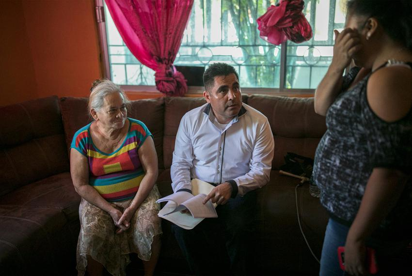 Immigration lawyer Eduardo Beckett sits next to his client, Bertha, as he speaks to Elena, in Ciudad Juarez on July 19, 2019…