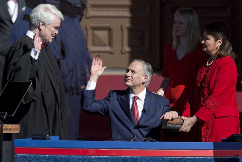 Texas Supreme Court Chief Justice Nathan Hecht swears in Greg Abbott as the 48th governor of Texas in a ceremony on the so...